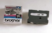 Brother TX-3551 1 In. White On Black Supply Tape printer supplies by Brother